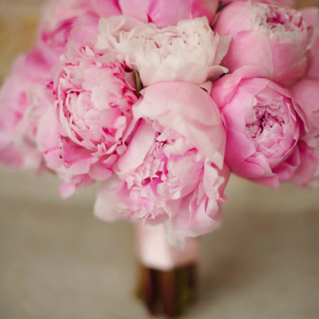 Detailed look at a soft pink peony bridal bouquet created by an Austin florist.